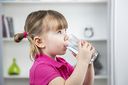 little girl drinking filtered water